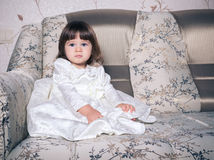 Baby dressed in white dress Stock Photography