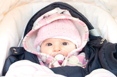 baby dressed for winter in the stroller newborn Royalty Free Stock Photography