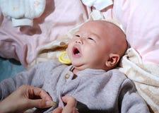 Baby dressing Stock Photos