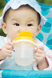 Baby drink water. From bottle stock photography