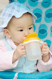 Baby drink water. From bottle royalty free stock images