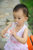 Baby drink water. A chinese baby drink water from a bottle Stock Photo
