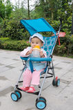 Baby drink water  in stroller Stock Photo