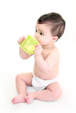 Baby drinking. Water from a beaker cup Royalty Free Stock Photography