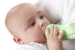 Baby drinking from a baby bottle Stock Photo