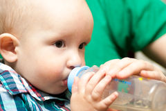 Baby drinking Royalty Free Stock Photography