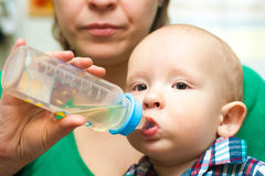 Baby drinking Royalty Free Stock Image