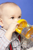 Baby drinking bottle Stock Photos