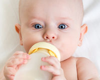 Baby drinking from bottle Stock Image