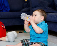 Baby drinking from a bottle. Cute Baby drinking from a bottle royalty free stock image