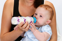 Baby drinking a bottle Stock Photos