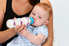 Baby drinking a bottle Royalty Free Stock Photos