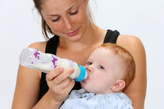 Baby drinking a bottle Royalty Free Stock Photo