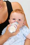 Baby drinking a bottle Royalty Free Stock Images