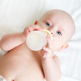 Baby drinking from bottle Royalty Free Stock Image