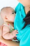 Baby drinking breastmilk royalty free stock photo