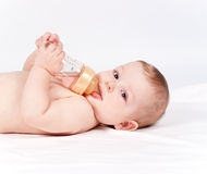 Baby drinking compot from bottle Stock Photo