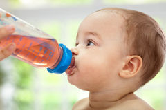 Baby drinking Royalty Free Stock Photo