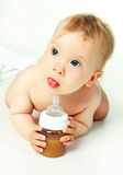 Baby drinking juice Royalty Free Stock Photography