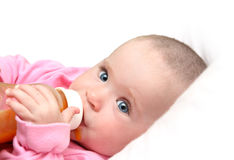 Baby drinking juice form bottle. Looking baby drinking juice form bottle close-up stock image