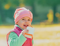 Baby drinking juice Stock Photo