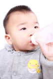 Baby drinking milk Stock Photos