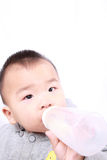 Baby drinking milk Royalty Free Stock Image