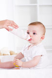 Baby drinking milk Stock Image