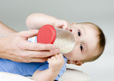 Baby Drinking Milk Royalty Free Stock Photos