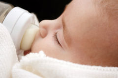 Baby  drinking milk Royalty Free Stock Images