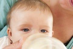 Baby drinking milk Stock Image
