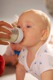 Baby drinking milk Stock Photos