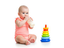 Baby drinking milk from bottle Royalty Free Stock Photo