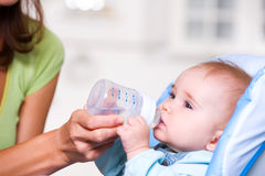 Baby Drinking Water Stock Images