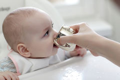Baby drinking water Royalty Free Stock Photo