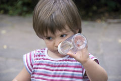 Baby drinking water Royalty Free Stock Photos