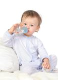 Baby is drinking water. From bottle stock photos