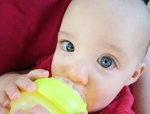 Baby Drinking Water Stock Image