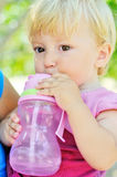 Baby drinking water Stock Photography