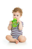 Baby drinking water from cup. Baby boy drinking water from cup isolated Royalty Free Stock Photos