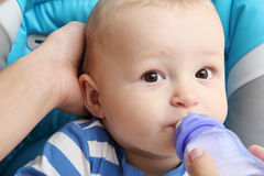 Baby drinks baby milk. Little baby drinks baby milk Royalty Free Stock Photo