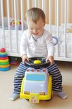Baby drives baby car Stock Images