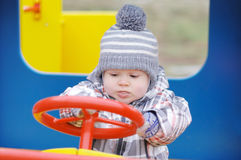 Baby driving car on playground Stock Photography