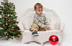 Baby dropping Christmas ornament Royalty Free Stock Photos