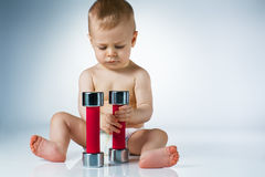 Baby with dumbbells Stock Photos