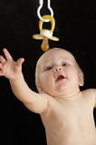 Baby with the dummy Royalty Free Stock Photo