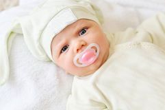 Baby with dummy Stock Photography