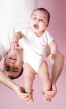 Baby dynamic gymnastics Royalty Free Stock Photos