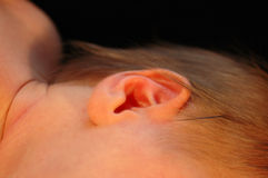 Baby ear. A closeup of a little ear of a newborn caucasian white baby stock photography