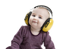 Baby with ear protection. Baby with yellow ear protection in loud environment. Isolated on white background Royalty Free Stock Photos
